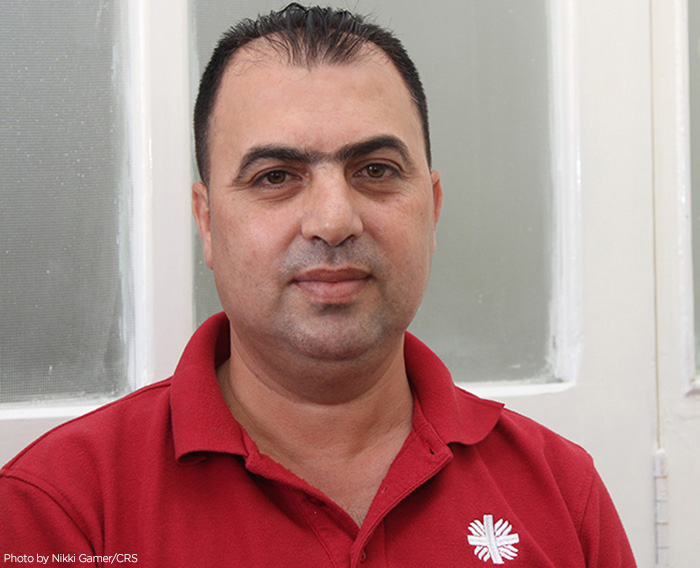 Syrian refugee Hassan Zoid owned his own business, but lost everything as war consumed his country. He volunteers helping other Syrian refugees, at a Caritas Jordan refugee center. CRS is assisting the Syrian people in transit all through the region.
