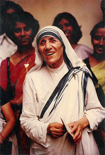 Mother Teresa holds a letter telling her the news that she has won the Nobel Peace Prize.