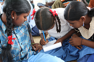 These 13-year-old girls were once dropouts. A CRS partner persuaded their parents to let them attend a bridge school to catch up on classes. They are now back in public school. Photo by Laura Sheahen/CRS