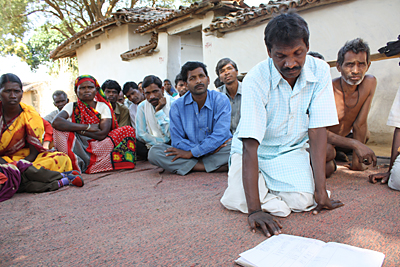 To curb human trafficking, residents of an isolated community in India keep a register of people who are leaving for big cities. Photo by Laura Sheahen/CRS