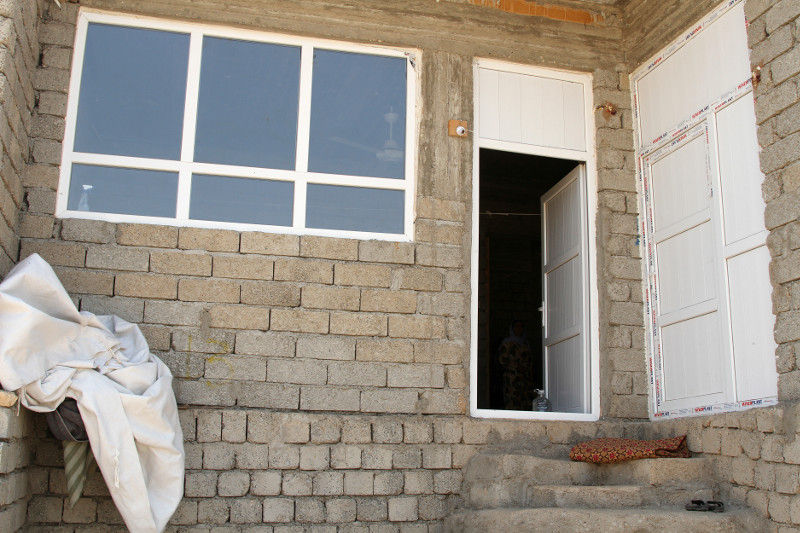 In and around Dohuk, in northern Iraq, CRS and its partner Caritas Iraq are upgrading hundreds of vacant and unfinished buildings that have become homes for displaced Iraqis like Wesal Badel and her family. Photo by Kim Pozniak/CRS