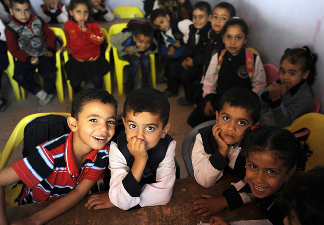 Children have a classroom again, thanks to community partnerships that are rebuilding neighborhoods and lives. Photo by Shareef Sarhan for CRS