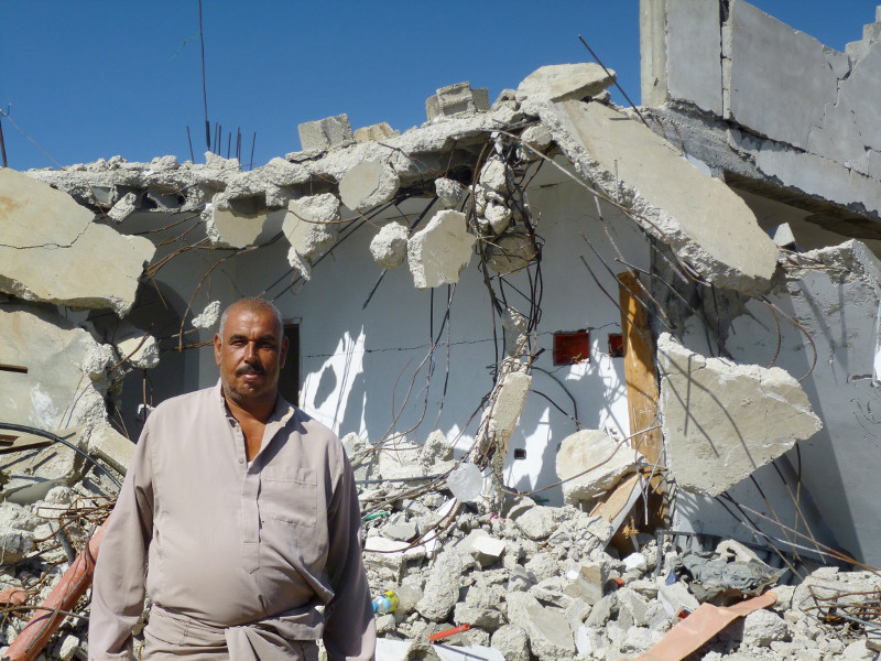"Without CRS' help, ""we wouldn't even have a shadow to sleep under,"" says Abu Hussein, whose home was reduced to rubble during the 2014 war in Gaza. Photo by Caroline Brennan/CRS"