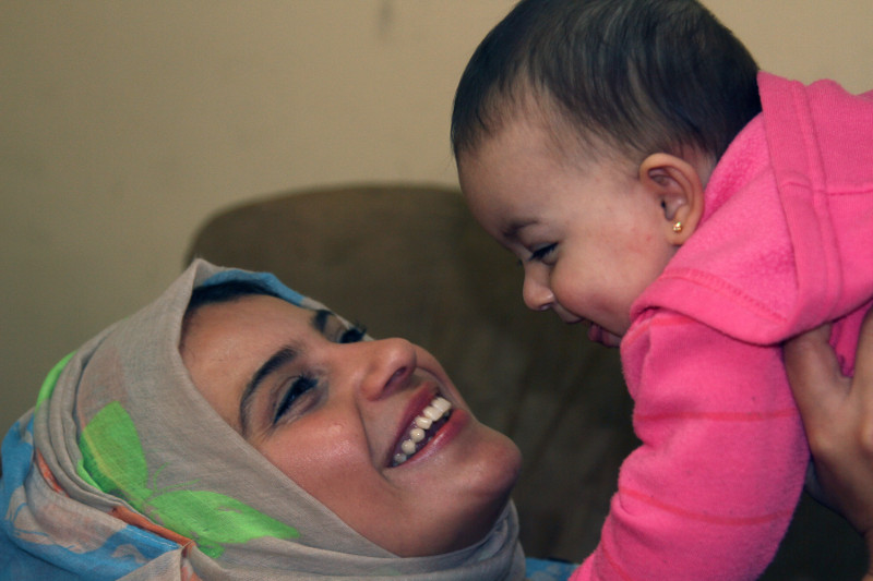 Noura gave birth to daughter Julia during the devastating violence last summer. Photo by Nikki Gamer/CRS