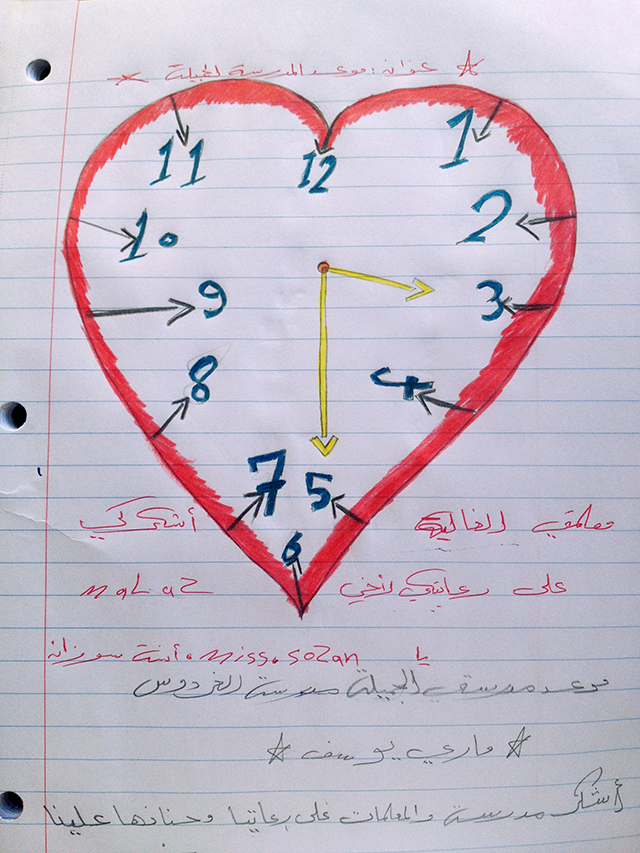 A heart-shaped drawing of a clock points to 3:30—the time school begins for the refugee children. Photo by Jimmy Patterson for CRS