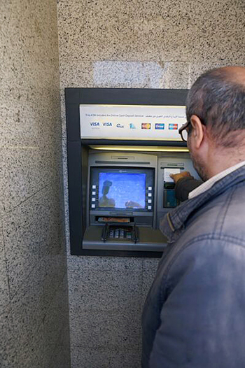 Debit cards provide refugees from Syrian conflict with choice and a sense of normalcy. Photo by Maggie Holmesheoran/CRS