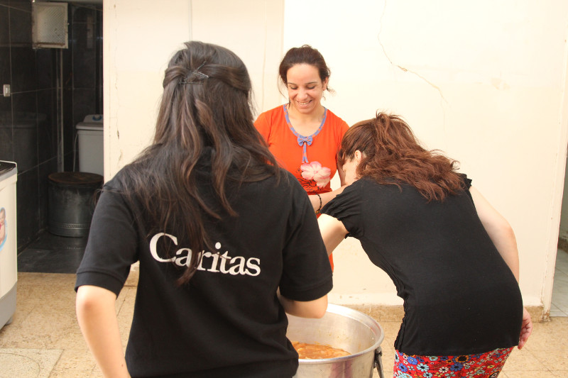 Diana helps prepare lunch for Iraqi refugees at a CRS-supported Caritas shelter in Madaba, Jordan.