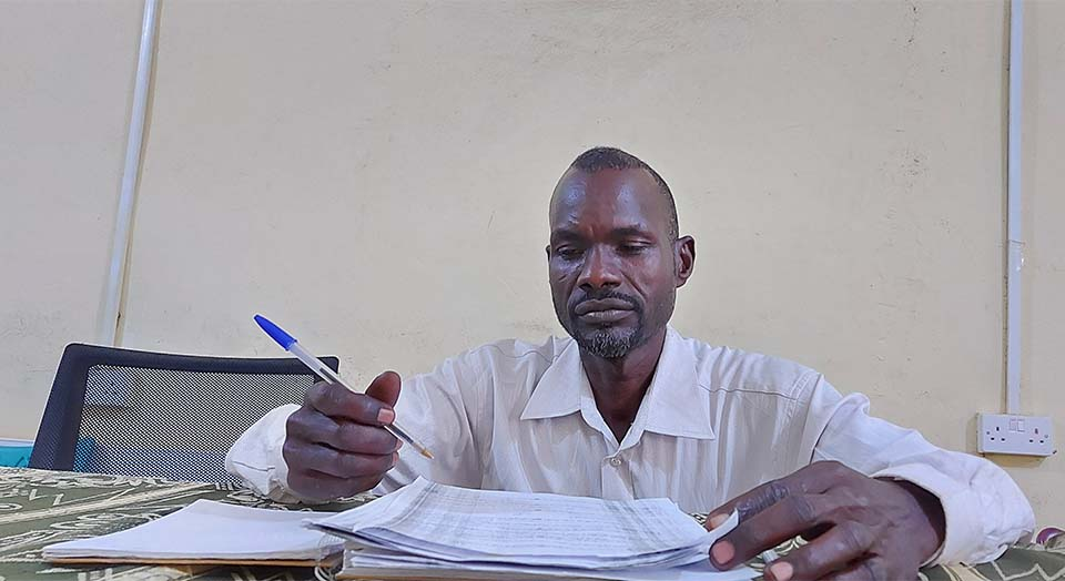 Sudanese project officer at his desk in West Darfur, Sudan
