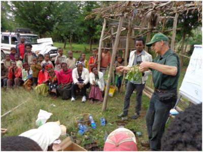 Dr. Hans Kandel trains villagers about dry bean nodulation.
