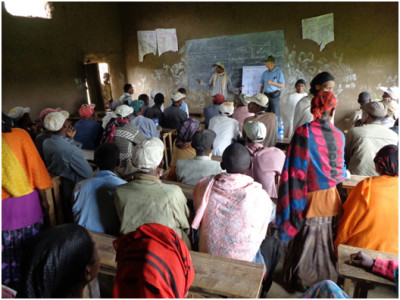 Kandel and his interpreter, Mr. Tessema, conduct a training on crop production in a local school.