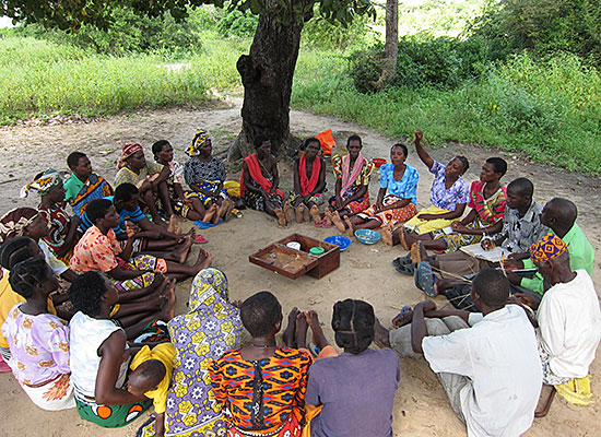 Savings and Internal Lending Community members meet in Malindi, Kenya. They come together on a weekly basis to save small sums of money. That money is then lent out to group members at interest rates determined by the group. Profits are divided among memb