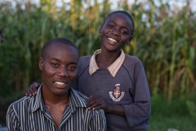 Felix and Levis Odhiambo lost their parents to complications from AIDS. Since age 13, Felix has been the main caregiver for his younger brother. Photo by Sara A. Fajardo/CRS