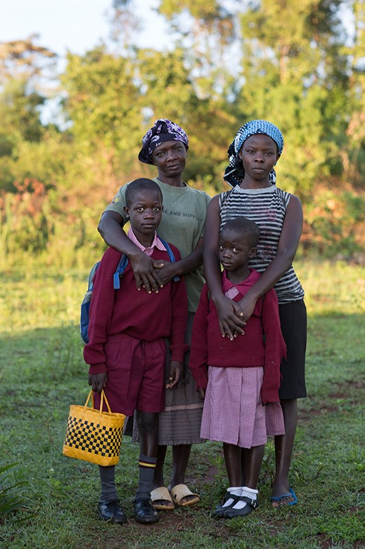 Mary Atieno Onyango, top left, lives a full life with her children, thanks to the support CRS provided after she tested positive for HIV. She now helps people living with the virus rebuild their lives. Photo by Sara A. Fajardo/CRS