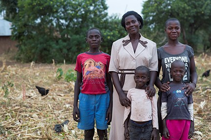 Janet Anyango Okeyo, with four of her six children, lost everything when her husband contracted HIV. The Children Behind, a CRS initiative, helped her earn enough to care for her family. Photo by Sara A. Fajardo/CRS