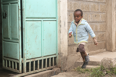 Brian Njoroge has a developmental delay, but has improved dramatically since his family enrolled in the SCORE-ECD project in Kenya. Photo by Philip Laubner/CRS