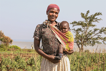 Women of the THRIVE Caregivers group irrigate their farm with water from Lake Victoria. Their shared work on the farm gives them purpose and self-esteem.