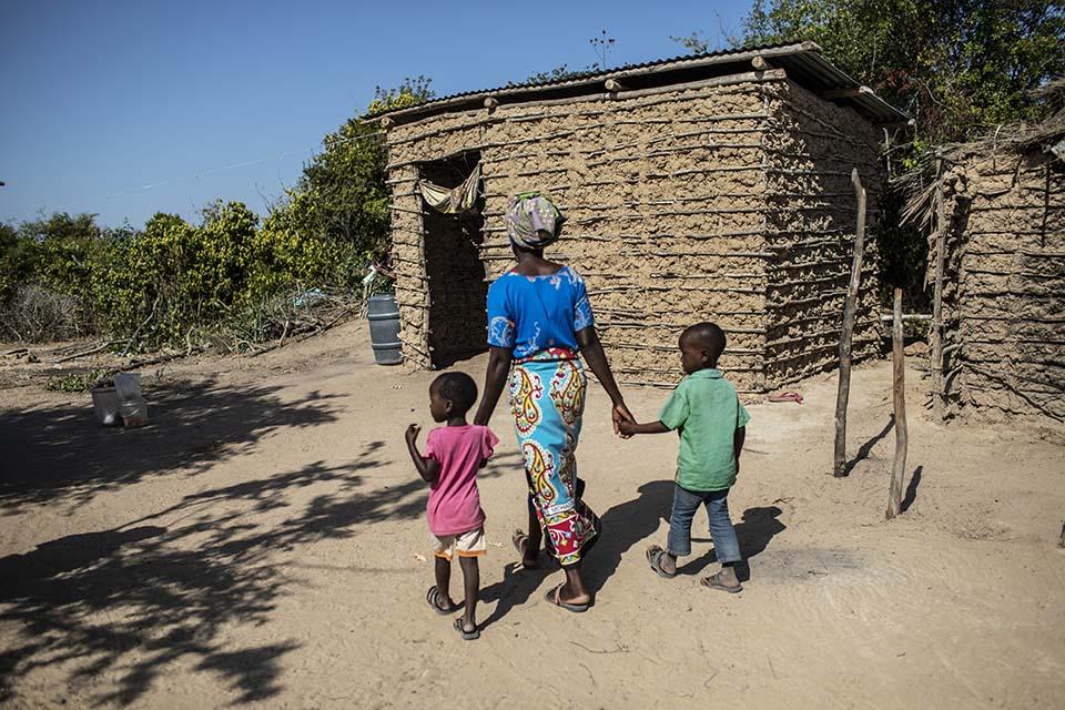 Kenya mother walks with her two children