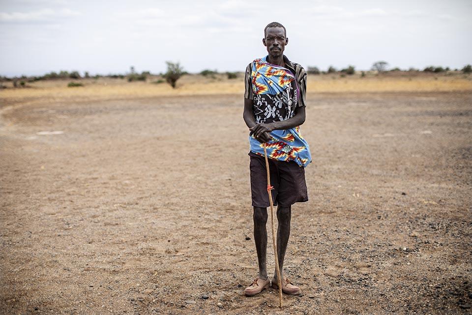 Kenya pastoralist stands in field
