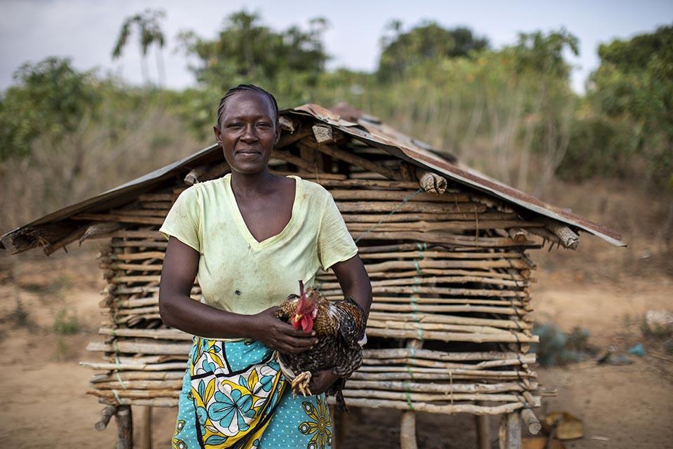 Kenyan woman holding a chicken