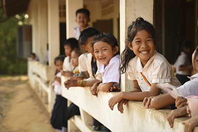 Children wait for school to start in Laos. Photo by Mark Metzger/CRS