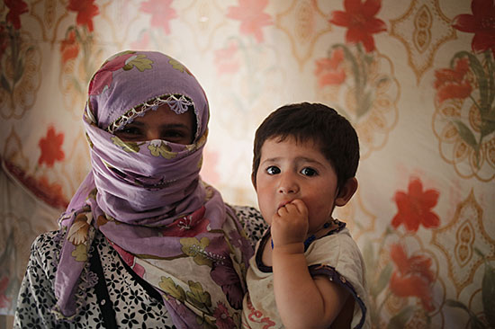 Zahaya and her son fled their home in Syria to escape the escalating violence and are now living in a tent in Lebanon and relying on support from CRS and our partners. Photo by Sam Tarling for CRS