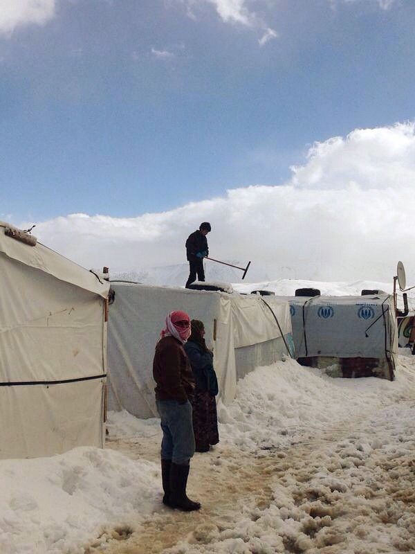 A powerful winter storm swept through the Middle East in January 2015, killing Syrian refugees in Lebanon and forcing thousands more to huddle for warmth in makeshift refugee camps. Photo courtesy of CLMC/Caritas