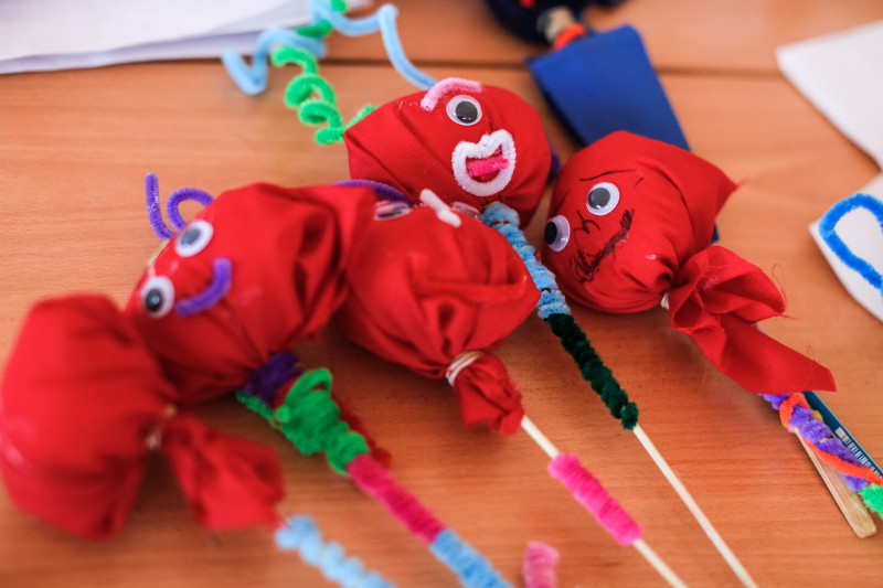 Puppets made by Syrian refugees at the summer camp run by CRS partners the Good Shepherd Sisters in the village of Deir al Ahmar, Lebanon. Photo by Sam Tarling for CRS