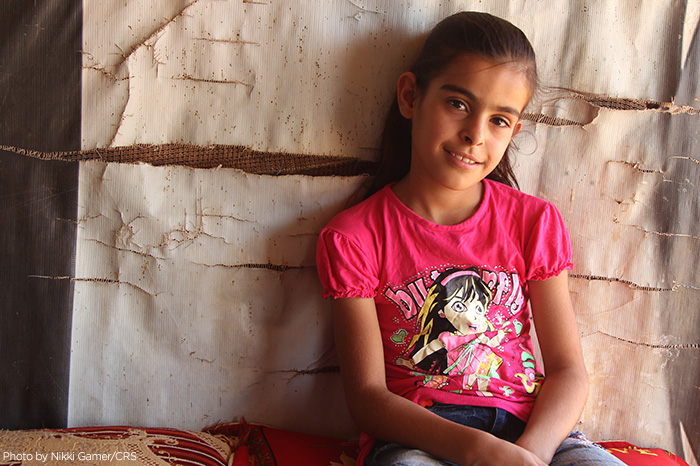 Syrian refugee Sakeena Mtier lives with her family of 11 in a shelter in Lebanon. Like many Syrian refugees, her family prays for peace and hopes to return home. CRS is assisting the Syrian people in transit all through the region.