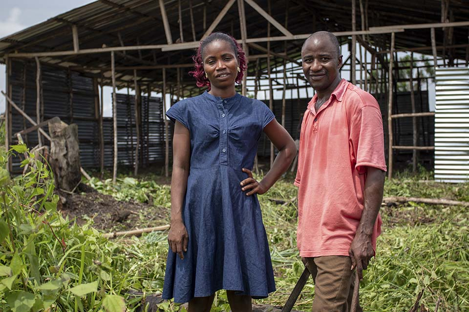 Liberian couple outside their under construction home