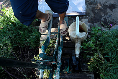Jean Marie Rasamimanana works a treadle pump to irrigate his family's farm in Madagascar. Photo by Sara A. Fajardo/CRS