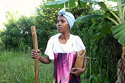 At her family plot in Madagascar, Albertine Sampy prepares to plant corn she purchased at a CRS-sponsored seed fair. Photo by Sara A. Fajardo/CRS