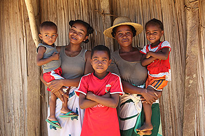 Madagascar moms Helene Baotlata, left, and Victorine Minoarison, in hat, teamed up to help their children recover after a monthly weigh-in showed they were undernourished. Photo by Sara A. Fajardo/CRS