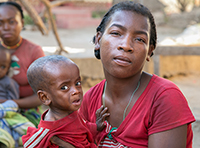 malnourished child with mother in madagascar during worst drought in 35 years