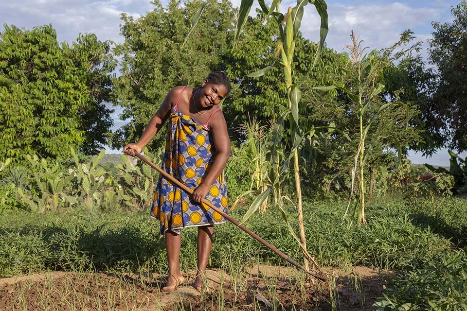 Madagascar farmer in her field