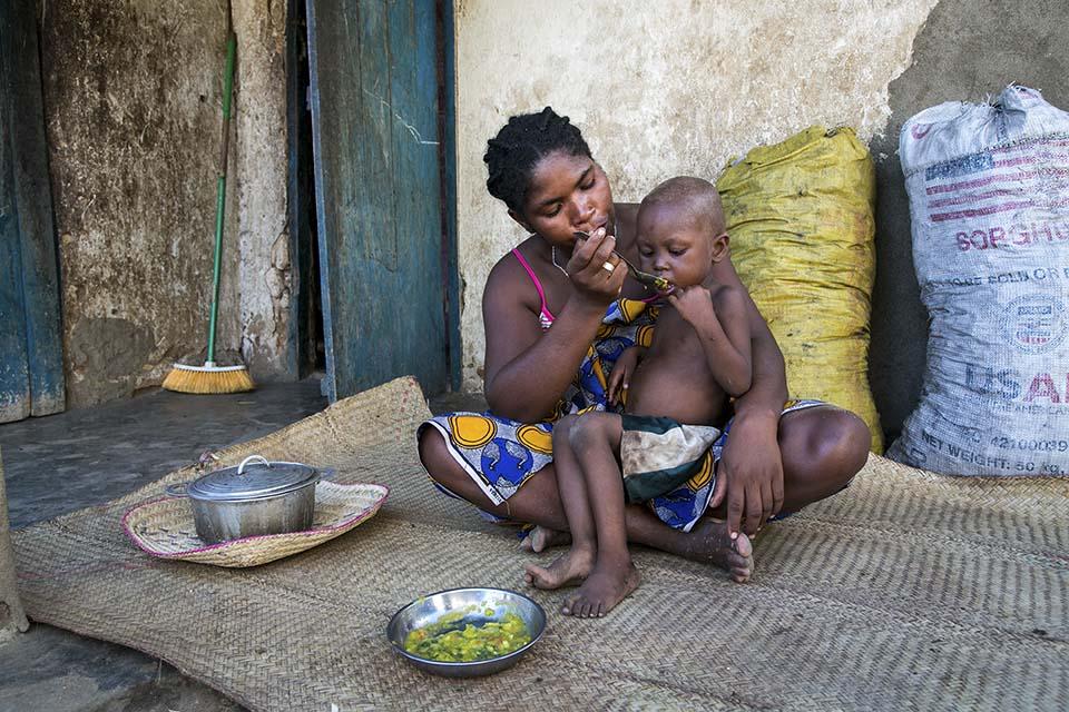 Madagascar mom feeds her child