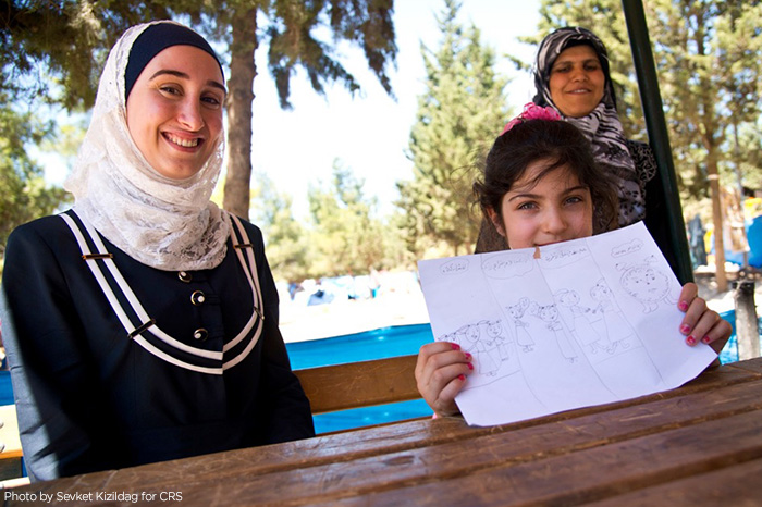 Syrian refugee Malak has been working as a teacher in in Turkey. Like her, her students are Syrian refugees, who have lost their homes. CRS is assisting the Syrian people in transit all through the region.
