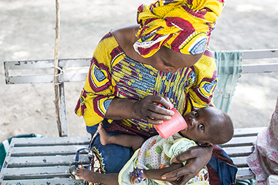 mother gives child malaria medicine