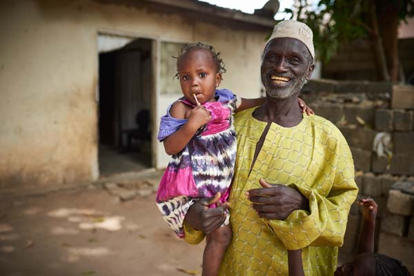 man with granddaughter in The Gambia