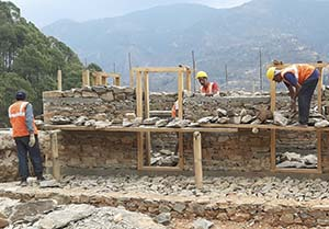 masons at work on a new house in Nepal