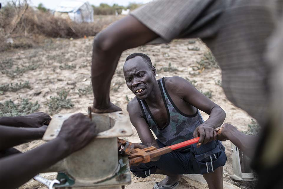 mechanics fix well pump in South Sudan