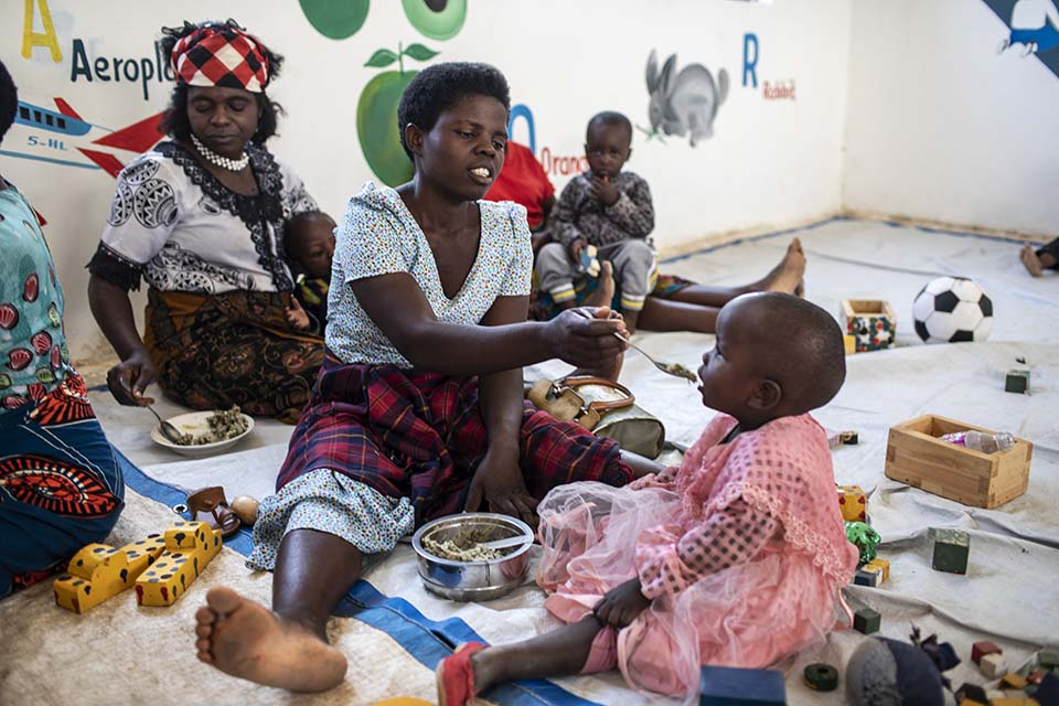 mother feeds her child in Tanzania