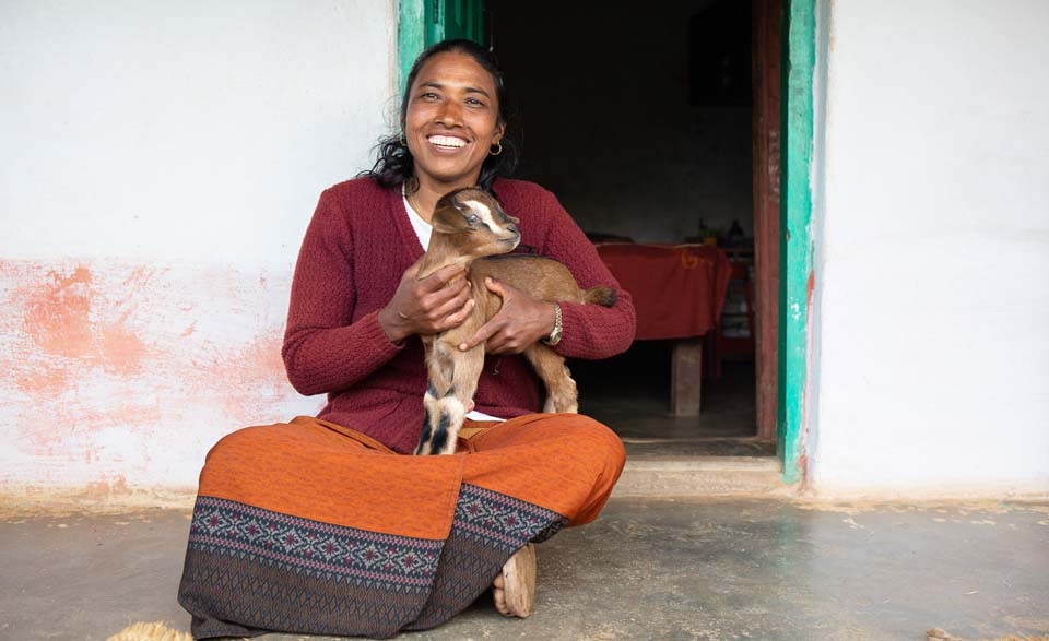 Nepal woman with goat