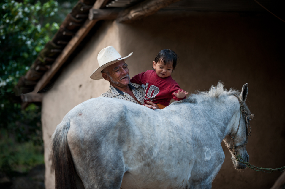 man and child with horse in Nicaragua
