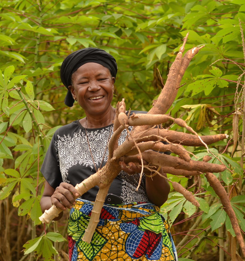 CRS helps Mwuese Jato produce and sell a new variety of cassava plants. She also participates in financial management training. With the income she earned from her last harvest, Mwuese supports her family. Photo by Michael Stulman/CRS
