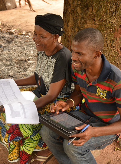 An app helps CRS collect and analyze information rapidly and efficiently from cassava farmers like Mwese Jato. The goal is to document progress and improve services. Photo by Michael Stulman/CRS