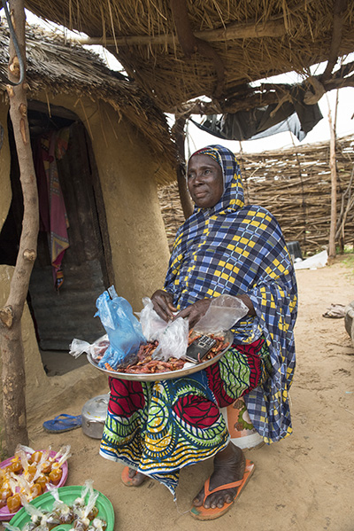 Kulu Asarara sells herbs and spices at her home in Kebbi State, Nigeria. Photo by Michael Stulman/CRS