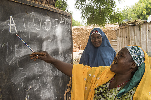 A literacy class in Ruwawuri, Nigeria helps women learn the skills needed to earn a living with dignity. Photo by Michael Stulman/CRS