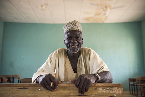 At age 66, Ibrahim Nadashi is learning to read and write in a CRS-supported class in Nigeria. Photo by Michael Stulman/CRS
