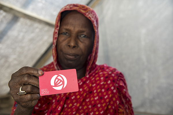 Nigerian woman who escaped Boko Haram holds a voucher card
