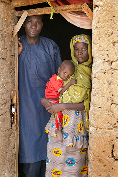 Nigerien families like Abdou Bydum and his wife Kolema Boucar, who have been sheltering Boko Haram survivors at their own expense, are now receiving cash-for-work aid from CRS. Photo by Michael Stulman/CRS